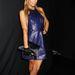 Paris Hilton színes bőrruhában ment megnézni a 2014-es nyári divatot.
