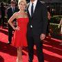 2013: egy díjátadón aktuális barátnőjével, Win McMurryvel, a riporterrel.