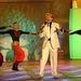 Komár egy 2004-es fellépésen, a szokásos, világos öltönyei egyikében. Az énekes a magyar Elvisként futott be karriert.