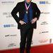 És John Travolta, aki vízfejű mikiegér lett