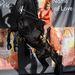 Júniusban aztán kiadta In The Name of Love (A szerelem nevében) című könyvét. A londoni bemutatóra egy lovat is kölcsönzött, és hogy biztosra menjen, mellhangsúlyos jelmezt is húzott