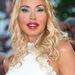 A pikánsan szétplasztikázott arcú hölgy Valeria Marini, divattervező, modell, színésznő és showgirl