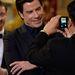John Travolta képhez pózol