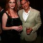 Christina Hendricks és a tévécsatorna egyik főnöke, Rob Sorcher a Mad Men első évadjának premierje alkalmából tartott bulin, 2007. július 15-én